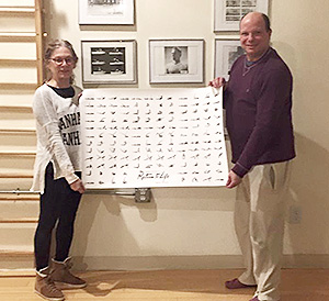 """Sean Gallagher and Lee Artur with the Pilates guild """"Return to Life"""" poster."""