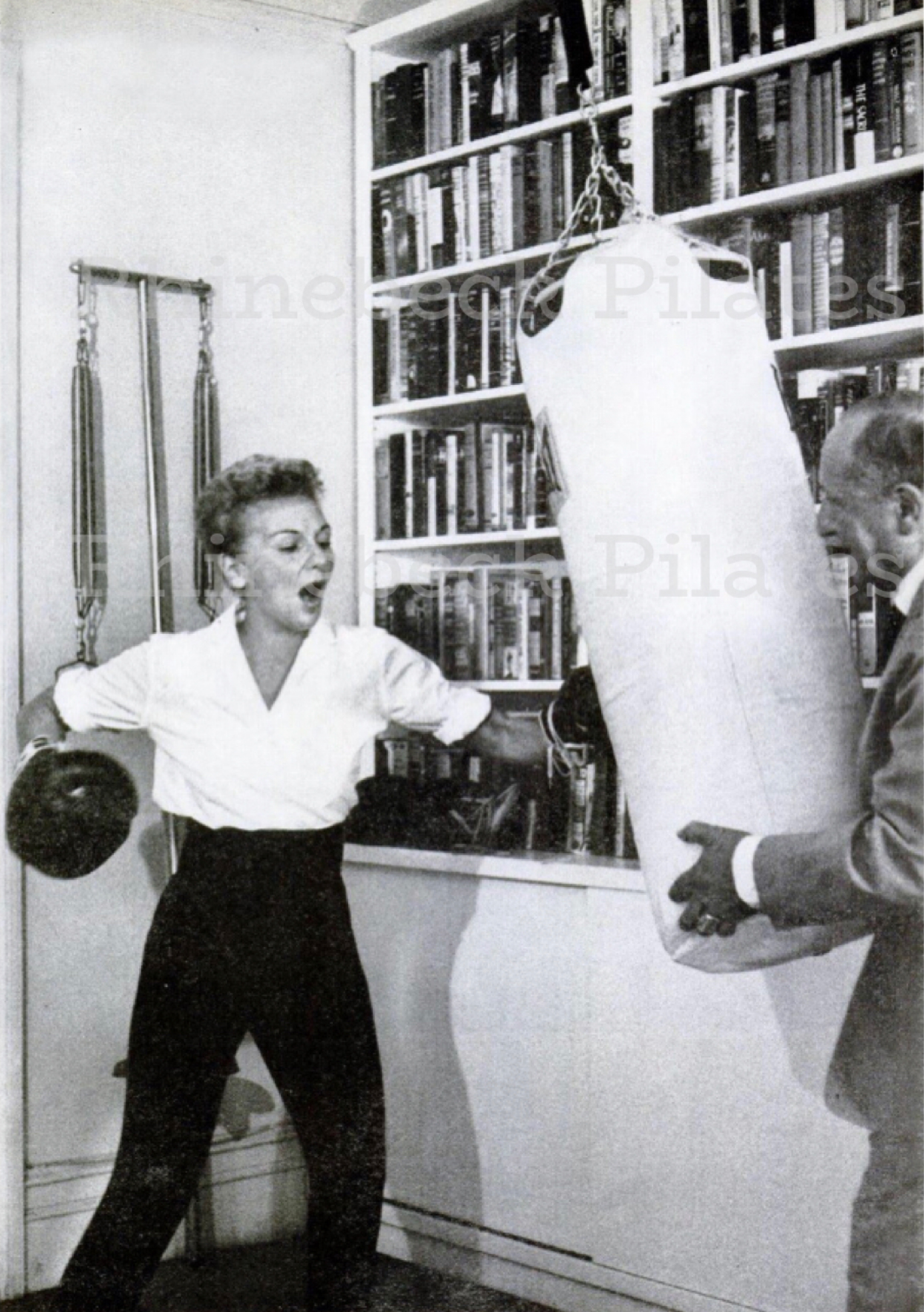 William Herman and Mary Martin with punching bag